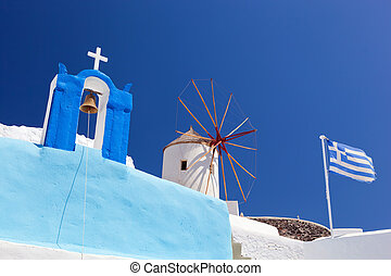 Oia town on Santorini island, Greece. Famous windmills,...