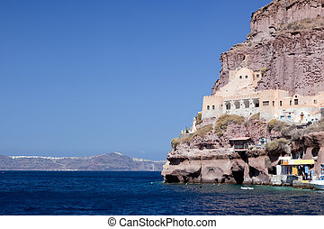 Ancient building in the port of Fira, the capital of...