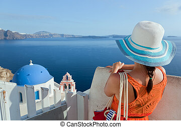 Happy tourist woman on Santorini island, Greece Travel -...