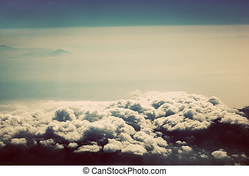 Sky with puffy clouds in vintage, retro style. As seen from...