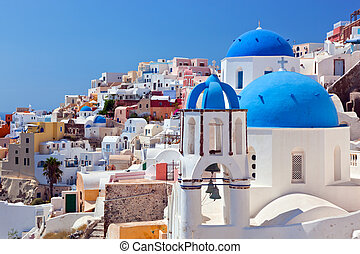 Oia town on Santorini island, Greece. Caldera on Aegean sea....