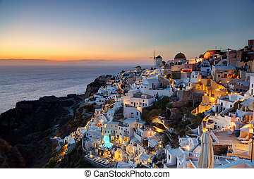 Oia town on Santorini island, Greece at sunset. Famous...