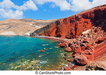 Red beach on Santorini island, Greece Volcanic rocks on...