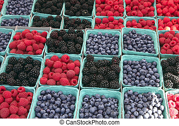 Farmers Market Berries Close up - Blueberries, blackberries,...