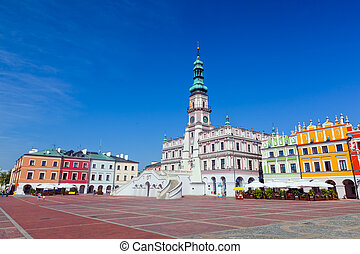 Zamosc, Poland. Historic buildings with the town hall. -...