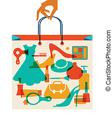 Woman hand holding hopping bag with woman cloth and accessories.