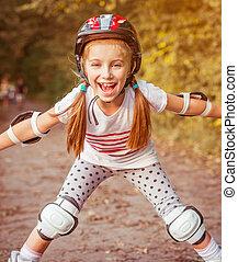 little girl on roller skates - happy little girl on roller...
