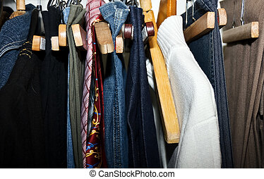 Clothes hanging in the cupboard