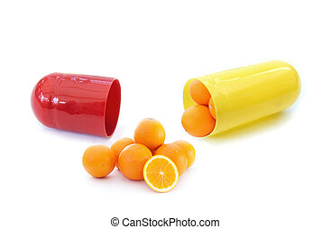 Vitamin C - Miniature oranges inside a vitamin pill capsule...