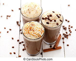 Ice coffee with whipped cream and coffee beans on a white...