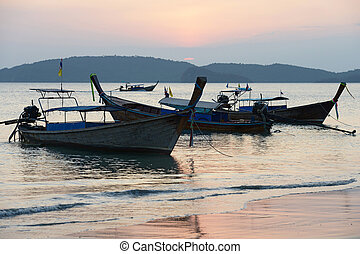 Ao Nang, Krabi, Thailand - Traditional thai boats at sunset...