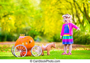 Little girl playing Cinderella - Cute curly little girl...