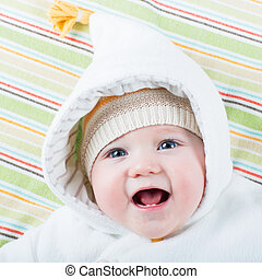 Happy baby in a hat - Happy laughing baby in a warm jacket...