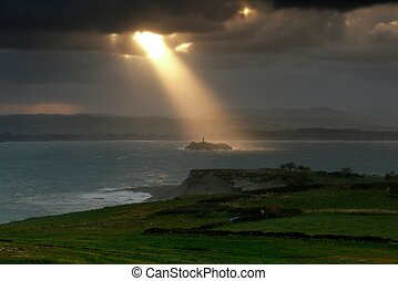 Magical sunbeam over the island lighthouse - Magical sunbeam...