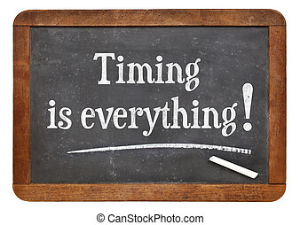timing is everything - reminder words on a vintage slate...