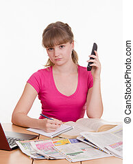 Girl on the phone refused to hire - A young girl sits at a...