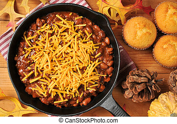 Chili with cheese in a cast iron skillet - A cast iron...