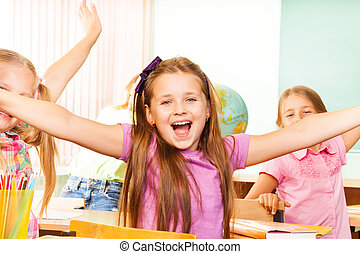 Happy Girl with arms apart laughs during lesson - Super...