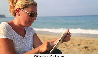 woman with digital tablet - Woman using digital tablet on...