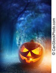 Spooky Halloween Night - A glowing Jack O Lantern in adark...