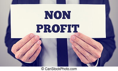 Businessman Holding Non Profit Signage - Businessman Holding...
