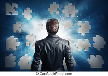 Puzzle solution - Businessman looking for the solution of...