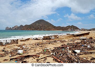 Trash on the Medano beach Cabo San Lucas and view of...