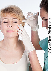 Botox injected in wrinkles - Vertical view of botox injected...