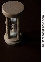 Wooden Hourglass with sand falling