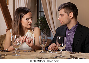 Meeting in restaurant - Horizontal view of young couple...