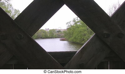 Diamond shaped hole with river outside - Looking out through...