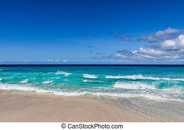 Sea surf in the Seychelles - Different nuances of blue color...