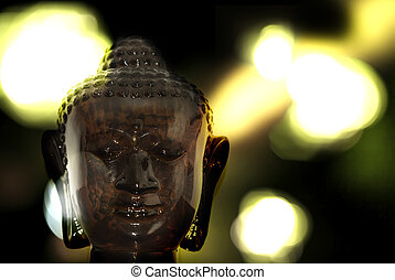 buddha bokeh - glass buddha with bokeh background
