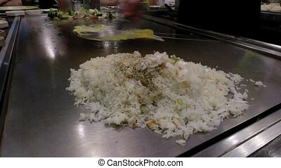 Chef cook preparing Japanese food - Japanese chef cooking in...