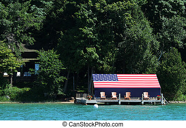 American flag covered boat house - Lake side boat house...