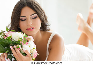 Beautiful bride holding nuptial bouquet