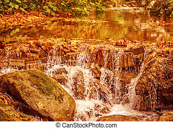Beautiful waterfall in autumn park