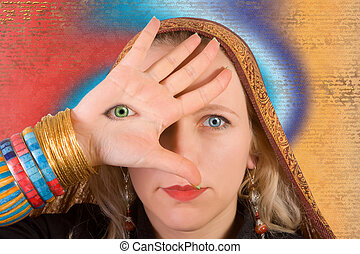 Third eye - A woman with a third eye on her hand - symbol of...