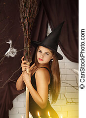 witch with a broom - Young beautiful witch with hat and...