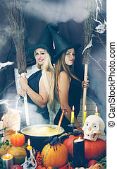 Two witches with a broom, tinted - Two young beautiful...