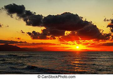 Intense sunset over ocean in Sicily