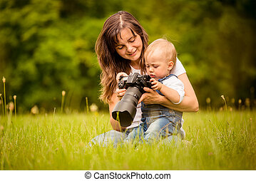 Mother, child and camera - Mother showing her kid captured...