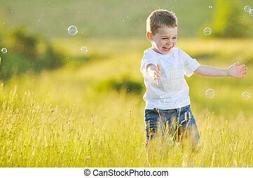 child bubble - happy young beautiful child have fun on eadow...
