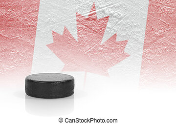 Hockey puck and a Canadian flag image. ?oncept