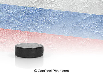 Hockey puck and a Russian flag - Hockey puck and the image...