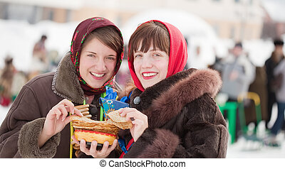 Women eating pancake during Shrovetide - Women in...