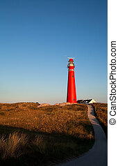path to red lighthouse before sunset, Schiermonnikoog,...