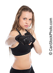 Portrait of young woman boxing in the studio. Isolated on...