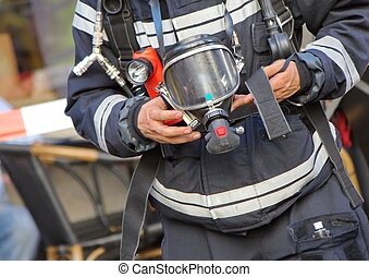 Firefighter holding oxygen or gas mask - Close up on...