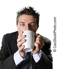 addict business man in suit and tie drinking cup of coffee...